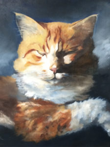 Orange cat painting; paws crossed, eyes closed contemplating its next move