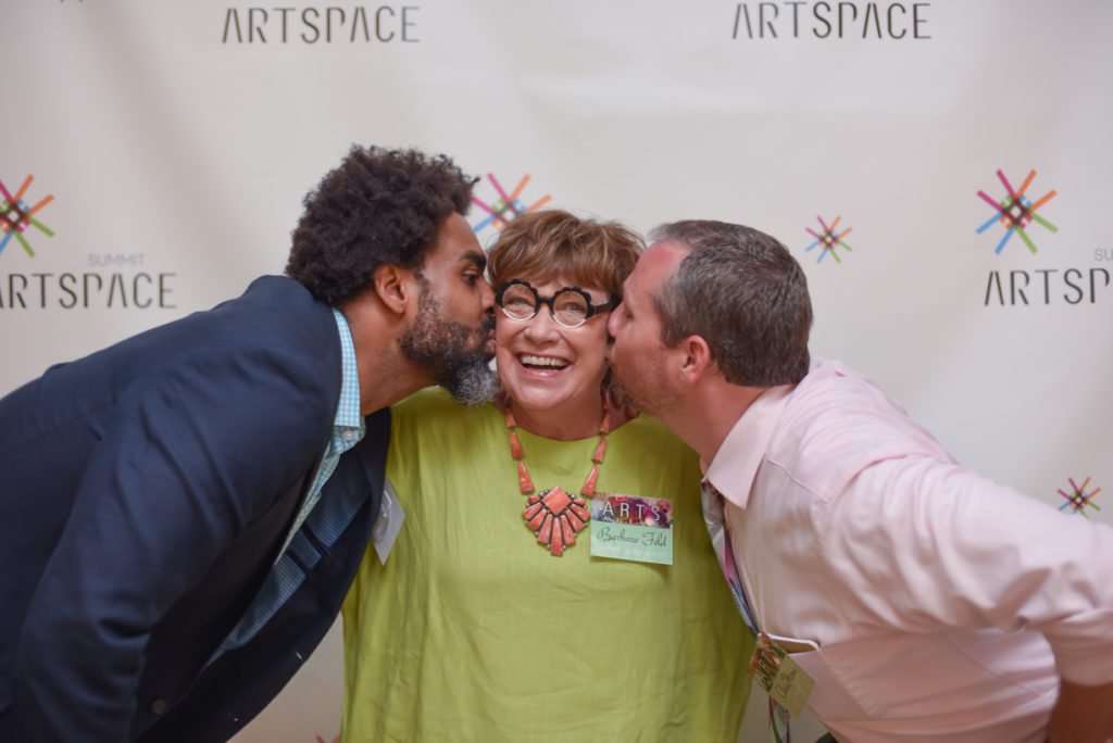 Lifetime Achievement honoree Barbara Feld is congratulated by 2016 Arts Alive emcees Roger Riddle, right, and Chris Horne with kisses