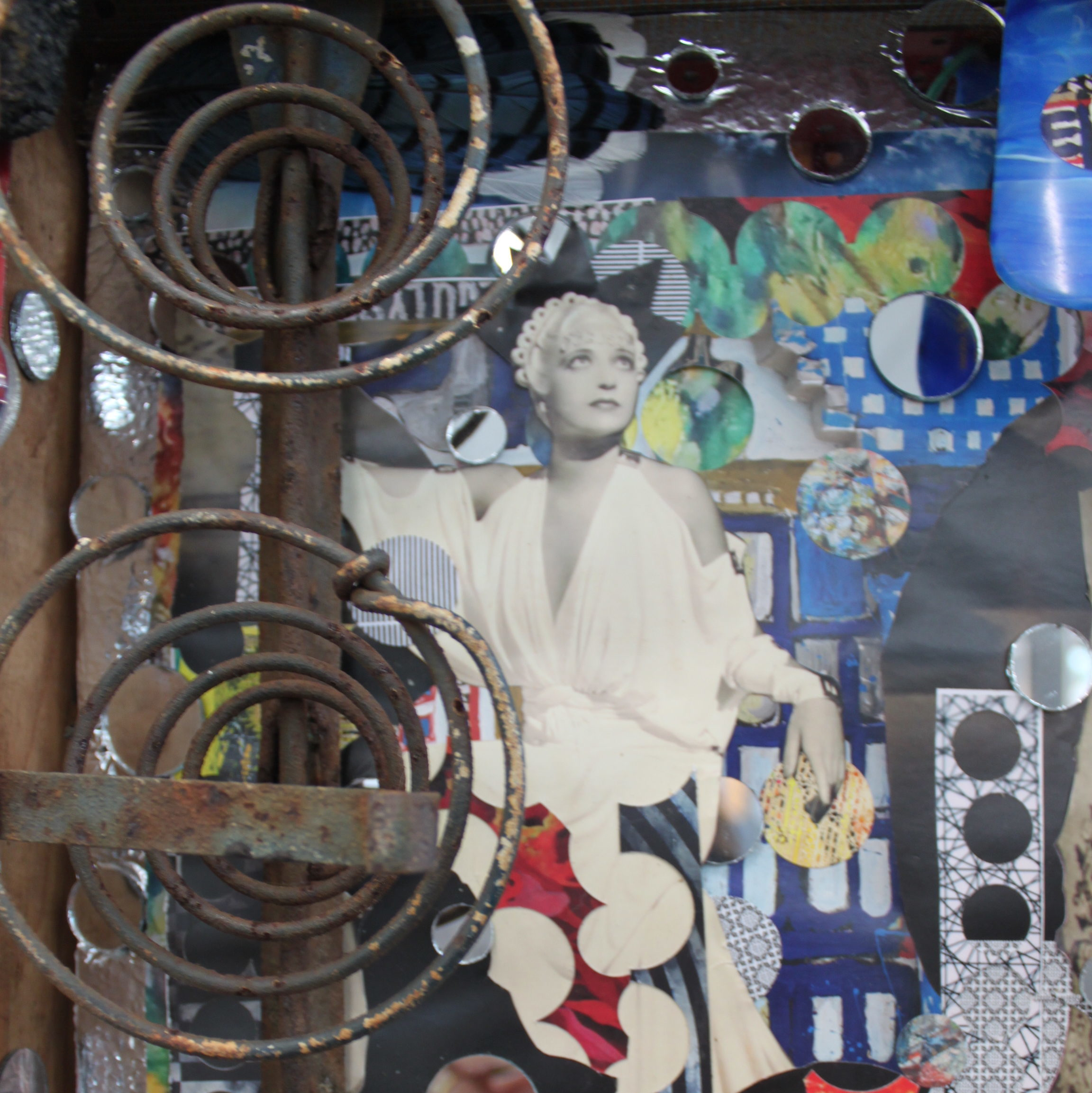 "A detail of the assemblage, ""mirror, mirror..."" by artist Gwen Waight that employs mirrors of all shapes and sizes and print materials"