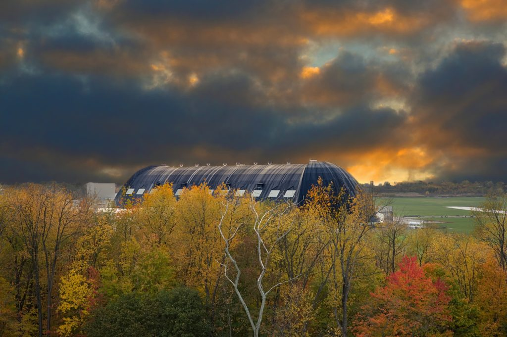 Photo of glowering fall skies over the blimp hangar in Akron Ohio