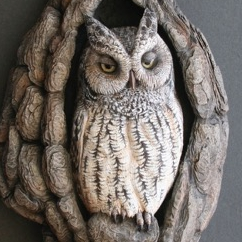 Life-like wood carving by artist Tom Baldwin of Song of Wood