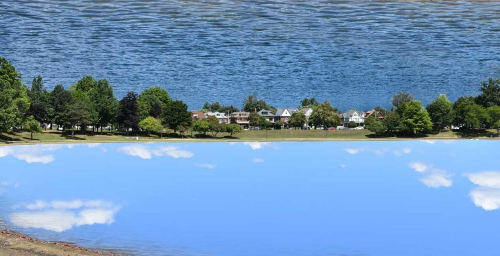 Reflection 1 by David Wood is a styled reflection of the sky over Lake Anna in Barberton OH